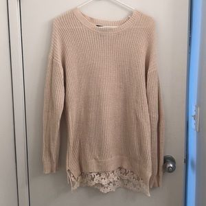 Beige sweater with floral lace at the bottom